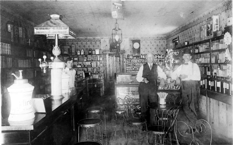 Milltown Pharmacy<br /> Left to right: Jim Lovejoy, Dr. W. L. Patten, Dr. J. V. Talley<br /> Photo courtesy of Frances Peck