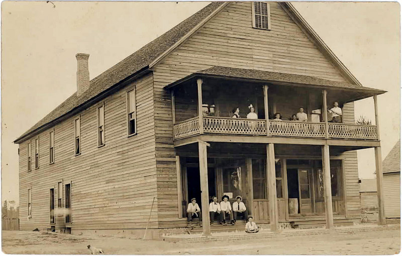 Ray City Hotel about 1912, Owned by J. H. Swindle and Jas. S. Swindle. J.F. Hineley operated the hotel and also had a small store (bottom floor right). On Sunday, April 25, 1915, Ray City was ravaged by a fire that burned several buildings, including the hotel and all of its contents. The total lost value was $6,000. The building stood where the Clements Fountain was later built.