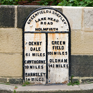 Old road sign in Holmfirth