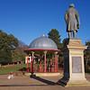 Statue of Titus Salt overlooking the new bandstand in Roberts Park, Saltaire.