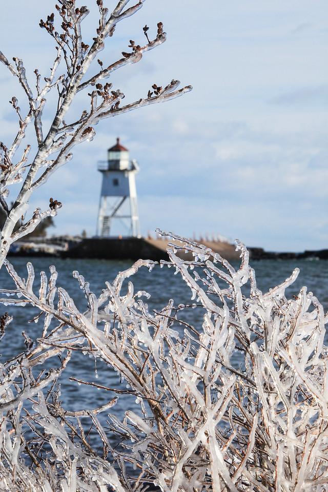 """GRAND MARAIS 0131<br /> <br /> """"Lighthouse framed in ice""""<br /> <br /> Grand Marais, MN"""