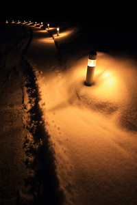"GRAND PORTAGE 3922  ""Light my way""  Sidewalk lights at the Grand Portage National Monument Heritage Center after a fresh snowfall."