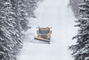 """TRANSPORTATION 1843<br /> <br /> """"Plowing the Old Highway""""<br /> <br /> A Cook County Highway Department truck plowing Old Highway 61 in Grand Portage, MN on January 3, 2015 during the first snow storm of the year."""