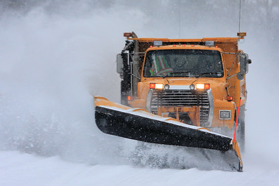 "TRANSPORTATION 3897  ""Cook County Blizzard Buster""  One of the county plow trucks plowing the Grand Portage Village roads after a snow storm."