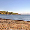 Cushendun beach, County Antrim, with the coast of Scotland in the far distance.