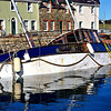 Fire-damaged boat in Strangford harbour, County Down
