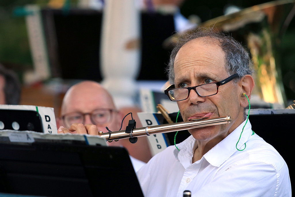. The Townsend Military Band performed at the weekly Thursday night\'s Summer Band Concert on the Town Common. Playing the flute with the band is David Deifik of Nashua, New Hampshire. SENTINEL & ENTERPRISE/JOHN LOVE