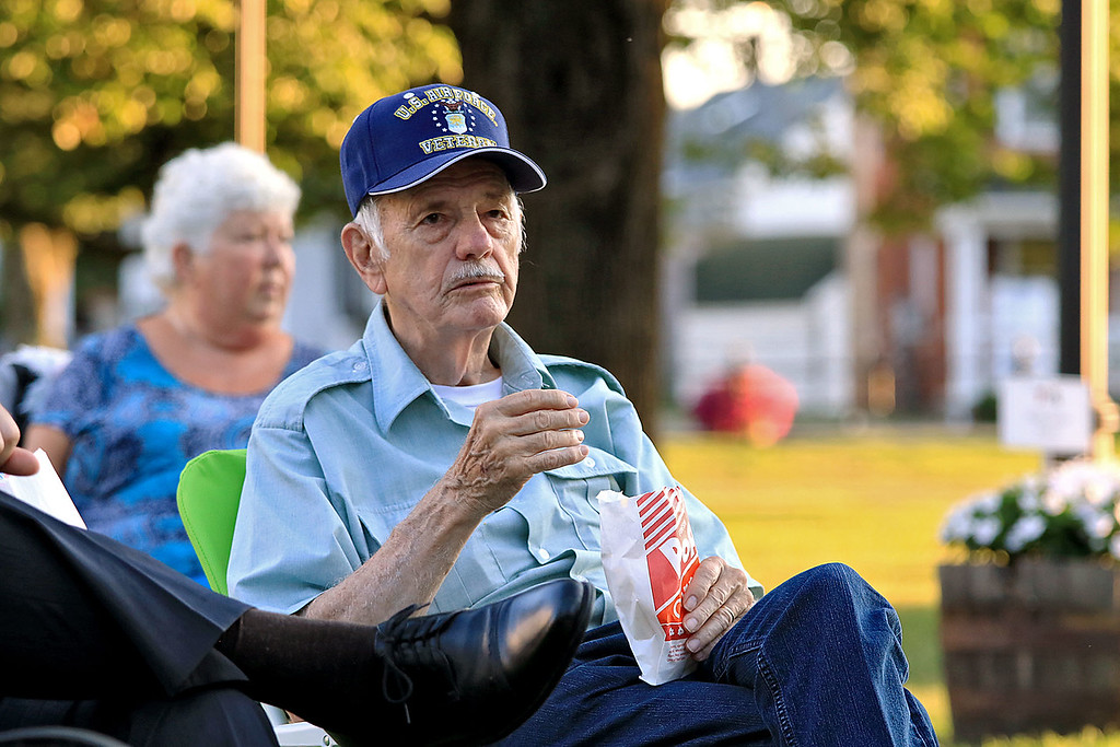 . The Townsend Military Band performed at the weekly Thursday night\'s Summer Band Concert on the Town Common. Enjoying some popcorn and good music is Airforce veteran Joe Potuin of Townsend. SENTINEL & ENTERPRISE/JOHN LOVE