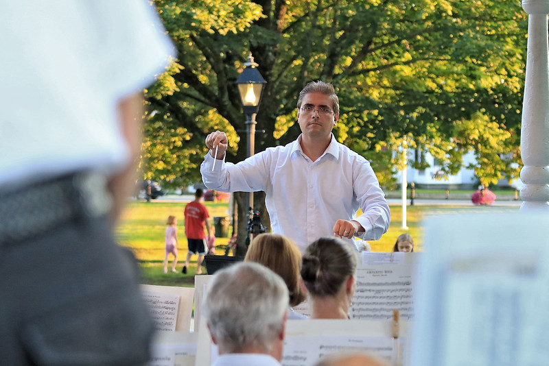 The Townsend Military Band performed at the weekly Thursday night's Summer Band Concert on the Town Common. Conductor Tom Souza of North Chelmsford conducts the band during one of the songs at the concert. SENTINEL & ENTERPRISE/JOHN LOVE