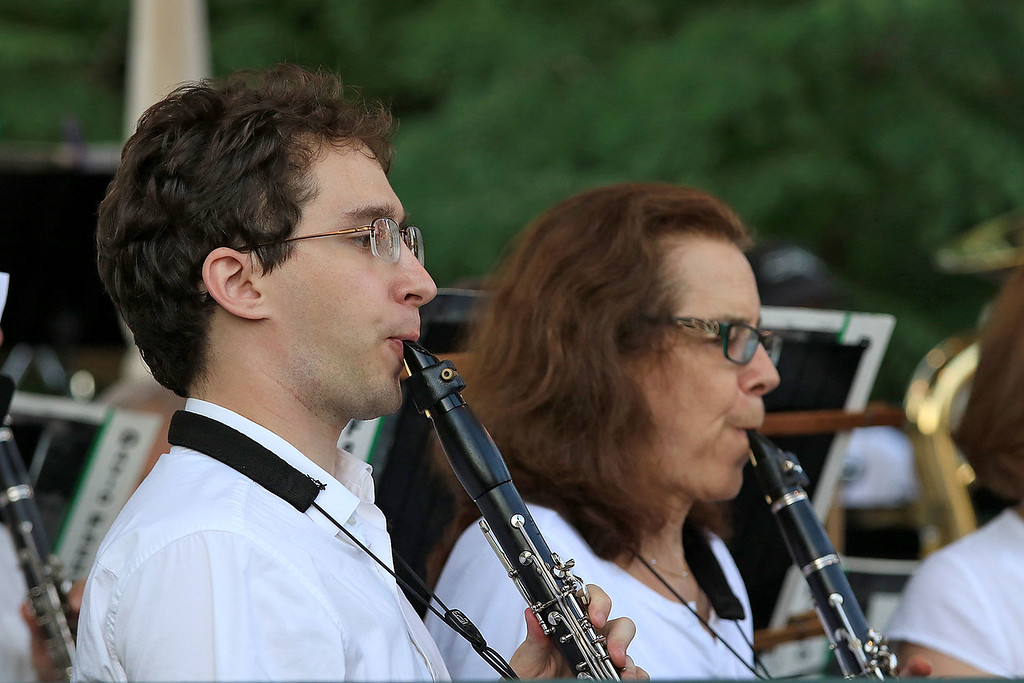 . The Townsend Military Band performd at the weekly Thursday night\'s Summer Band Concert on the Town Common. Joe Clark of Pepperell and Rochelle Goren of Nashua New Hampshire play the clarinet with the band during the concert. SENTINEL & ENTERPRISE/JOHN LOVE