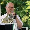 The Townsend Military Band performed at the weekly Thursday night's Summer Band Concert on the Town Common. Stephen Taylor of Amherst New Hampshire plays the French horn with the band. SENTINEL & ENTERPRISE/JOHN LOVE