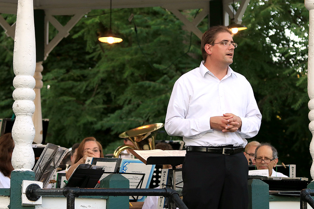 . The Townsend Military Band performed at the weekly Thursday night\'s Summer Band Concert on the Town Common. Conductor Tom Souza of North Chelmsford addresses the crowd just before one of the songs at the concert. SENTINEL & ENTERPRISE/JOHN LOVE