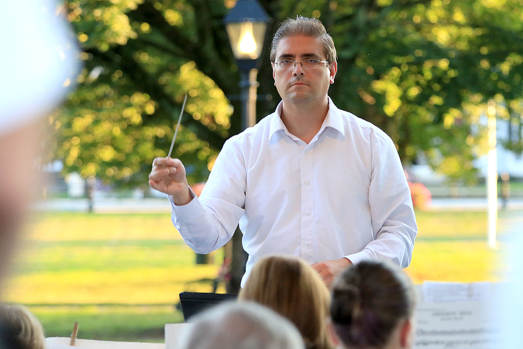 . The Townsend Military Band performed at the weekly Thursday night\'s Summer Band Concert on the Town Common. Conductor Tom Souza of North Chelmsford conducts the band during one of the songs at the concert. SENTINEL & ENTERPRISE/JOHN LOVE