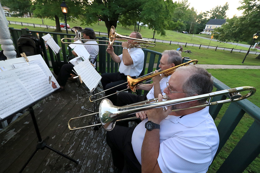 . The Townsend Military Band performed at the weekly Thursday night\'s Summer Band Concert on the Town Common. The trombone section of the band plays during one of the songs. SENTINEL & ENTERPRISE/JOHN LOVE