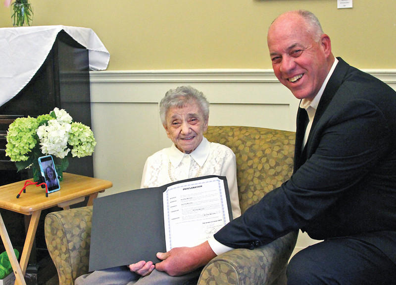 ". Here Chairman, Townsend Board of Selectmen, Gordon Clark, presents the Proclamation he just read to Dorothy ""Dot\"" Manceau, awarded the Boston Post Cane. Nashoba Valley Voice Photo by David H. Brow"