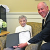 "Here Chairman, Townsend Board of Selectmen, Gordon Clark, presents the Proclamation he just read to Dorothy ""Dot"" Manceau, awarded the Boston Post Cane. Nashoba Valley Voice Photo by David H. Brow"
