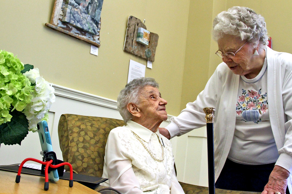 ". Dorothy ""Dot\"" Manceau, on left, chats with her friend, Sally Ross of Ashby, after she received the Boston Post Cane Award. Nashoba Valley Voice Photo by David H. Brow"