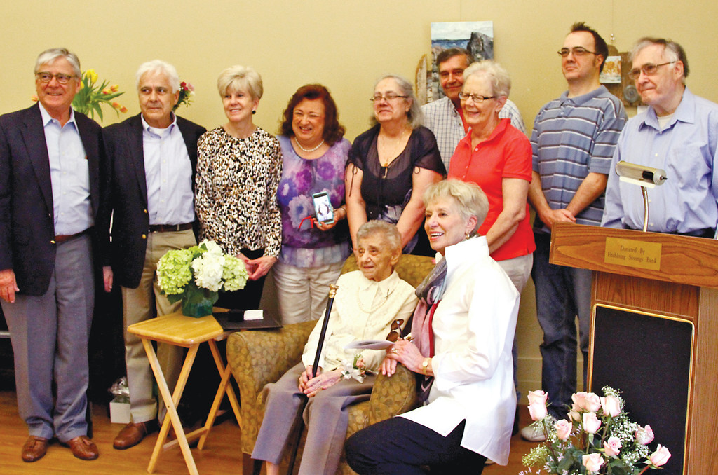 ". Family members of Dorothy ""Dot\"" Manceau, after she received the Boston Post Cane, L-R, Jim McWilliams, Jack McWilliams, Helen McWilliams, jeanne Grosvenor,Lynda Durrin, Chuck Grosvenor, Pat Dorcelle, Bri Durrin, grandson, Brian Durrin and kneeling with Dot is Carol McWilliams. Nashoba Valley Voice Photo by David H. Brow"