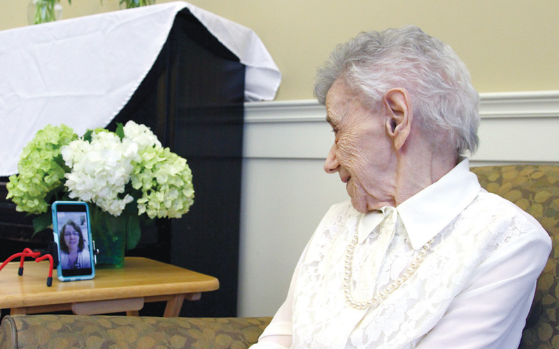 ". Dorothy ""Dot\"" Manceau, talks to one of her daughters, Mary Ford, during a live stream from Okla.,as she awaits the start of her being awarded the Boston Post Cane. Nashoba Valley Voice Photo by David H. Brow"