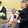 """Here Father Jeremy St. Martin from St. John's Catholic Church, gives Dorothy """"Dot"""" Manceau a blessing during his closing prayer after she received the Boston Post Cane. Nashoba Valley Voice Photo by David H. Brow"""
