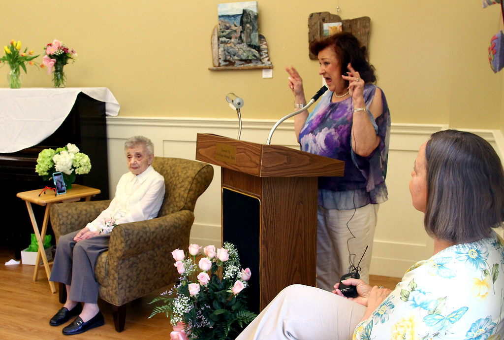". Dorothy ""Dot\"" Manceau, on left, listens to her daughter, jeanne Grosvenor, speaking about her, and on right is Karin Canfield Moore, Director of Townsend Senior Center, during Boston Post Cane award ceremony. Nashoba Valley Voice Photo by David H. Brow"