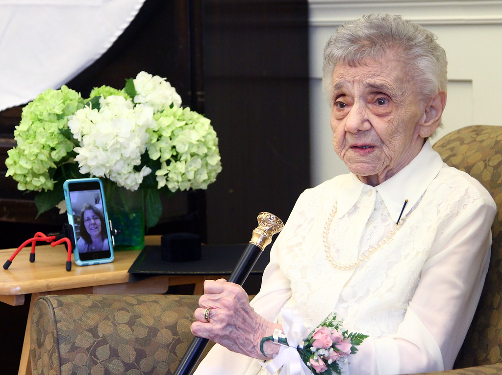 """. Dorothy \""""Dot\"""" Manceau, who will be 99 on May 20th, holds the Boston Post Cane just presented to her at the Townsend Senior Center. Nashoba Valley Voice Photo by David H. Brow"""