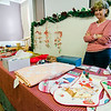Marcia Scofield sells crafts during the annual holiday fair at United Methodist Church in Townsend on Saturday afternoon. SENTINEL & ENTERPRISE / Ashley Green
