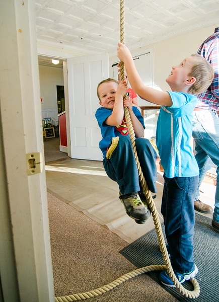 Wesley, 4, and Tristan Thomas, 6, ring the church bell during the annual holiday fair at United Methodist Church in Townsend on Saturday afternoon. SENTINEL & ENTERPRISE / Ashley Green