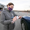 Volunteer Stacy Sheldon checks in the residence as they drive up in their cars on Friday, November 20, 2020 at the Townsend Ecumenical Outreach center's food distribution. SENTINEL & ENTERPRISE/JOHN LOVE