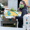 Volunteer Kelly Kelly helps stock the tables outside on Friday, November 20, 2020 at the Townsend Ecumenical Outreach center's food distribution. SENTINEL & ENTERPRISE/JOHN LOVE