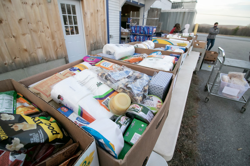 Boxes of food wait for residence in need to show up on Friday, November 20, 2020 at the Townsend Ecumenical Outreach center's food distribution. SENTINEL & ENTERPRISE/JOHN LOVE