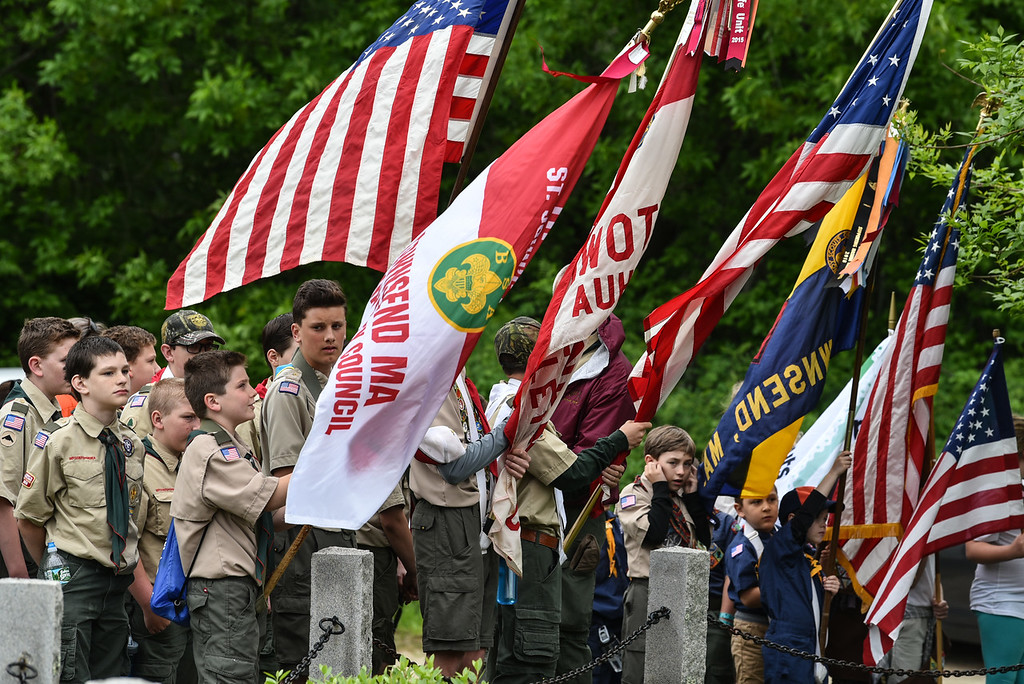 . Boy Scouts stand alongside the color guard at the end of the National Anthem during Sunday\'s Memorial Day parade in Townsend.  SENTINEL & ENTERPRISE JEFF PORTER