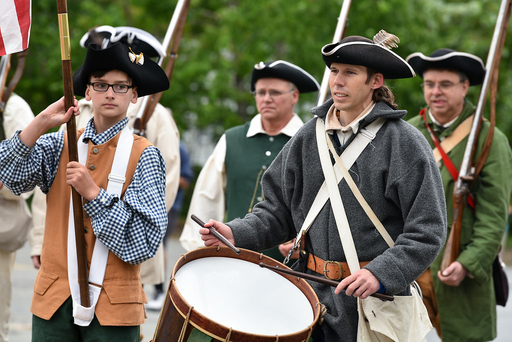 . Townsend Minutemen Riley Rebovich (left) and Robert Sigmon march through the streets of Townsend during Sunday\'s Memorial Day parade.  SENTINEL & ENTERPRISE JEFF PORTER