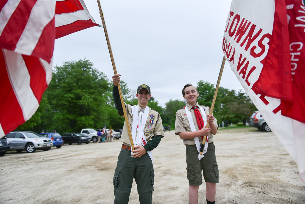 . Devin Carter, 18 (left) and Tim Shannon, 13, of Troop 10 Townsend pose with flags during Sunday\'s Memorial Day parade in Townsend.  SENTINEL & ENTERPRISE JEFF PORTER