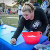 Susan Studham of Fitchburg signs poster at the vigil in Townsend to remeber those who have passed from an overdose. SUN/Caley McGuane