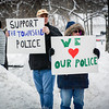 At left, Ken Mattson of Townsend and Leanne Jackson of Townsend attend the rally with signs in support for the Townsend Police Dept. SUN/Caley McGuane