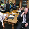 Residents filled the Townsend Selectmen's chambers during their meeting set for 6 p.m. on Tuesday February 14, 2017 and caused them to chancel the meeting. Selectman Gordon Clark uses his cell phone to try and reach the Townsend Police while in the chambers with the residents. SENTINEL & ENTERPRISE/JOHN LOVE