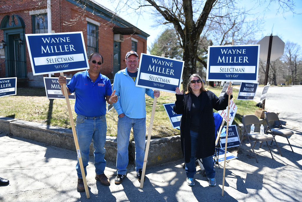 . Left to right; Jospeh Shank, Wayne Miller, and Linda Johansen stand outside Townsend Town Hall to support Wayne in his candidacy for Selectman during the town elections on Monday.  SENTINEL & ENTERPRISE JEFF PORTER