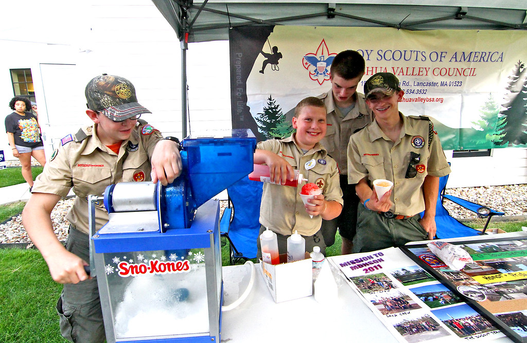 . Making up Sno-Kones at the National Night Out are Boy Scouts from Troop 10, L-R, Justin Carter,16, Chris Bjornson,13, Nathan Dorman,15, and Devin Carter,17. Nashoba Valley Voice Photo by David H. Brow
