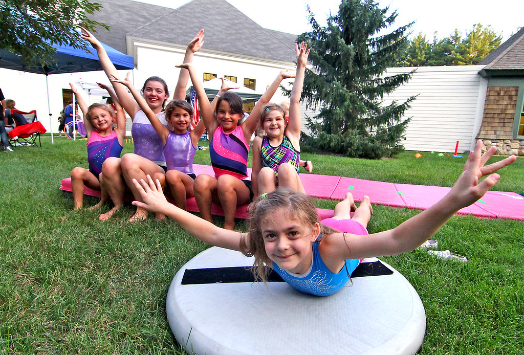 . Girls from Rock&Roll Gymnastics in Townsend, take a break from demos to pose for a photo, L-R, MacKenzie York,6, Lillianna Huber,16 (also an instructor), Grace Cavaioli, 8, Ava Powers,8, Kaely Turgeon,8, and in front is Bellarose Huber,7. Nashoba Valley Voice Photo by David H. Brow
