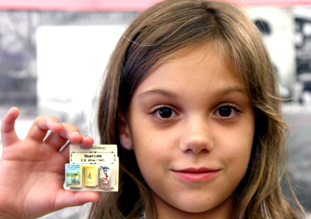 . Layla Valley, 8, holds up very tiny real books of Charlotte\'s Web and Stuart Little, by E. B. White, her grandmother is Lindsay Morand the Grand Neice of the author. Nashoba Valley Voice Photo by David H. Brow