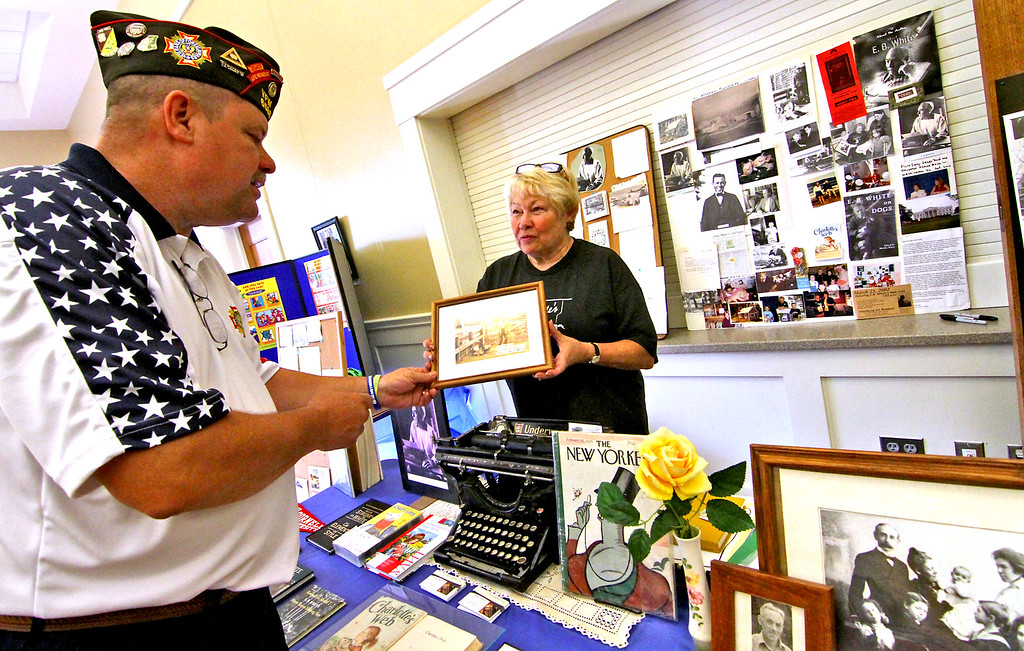 . On left is Keith Jackson, VFW State Senior Vice Commander being shown an old photograph of E.B. White (Author of Charlotte\'s Web & Stuart Little), by his grand niece, Lindsay Morand, at the Naltional Night Out in Townsend. Nashoba Valley Voice Photo by David H. Brow
