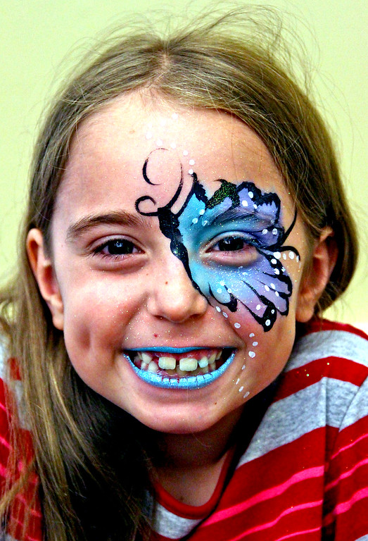 . Summer Goyette, 7, is all smiles after having her face painted at the National Night Out in Townsend. Nashoba Valley Voice Photo by David H. Brow