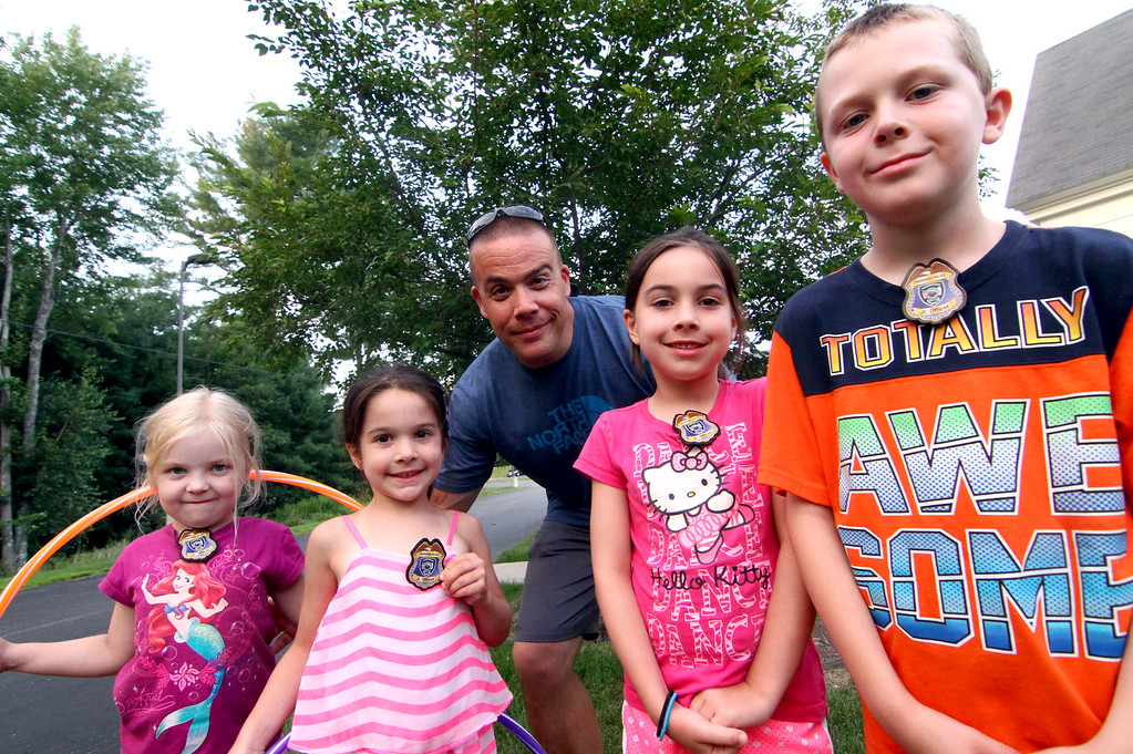 . Local kids after being pinned as Jr Officers by their dad John Gallagher, L-R, Kyliegh Shea,5, Kate Gallagher,6, Maeve Gallagher,6, and Aiden Shea,9. Nashoba Valley Voice Photo by David H. Brow