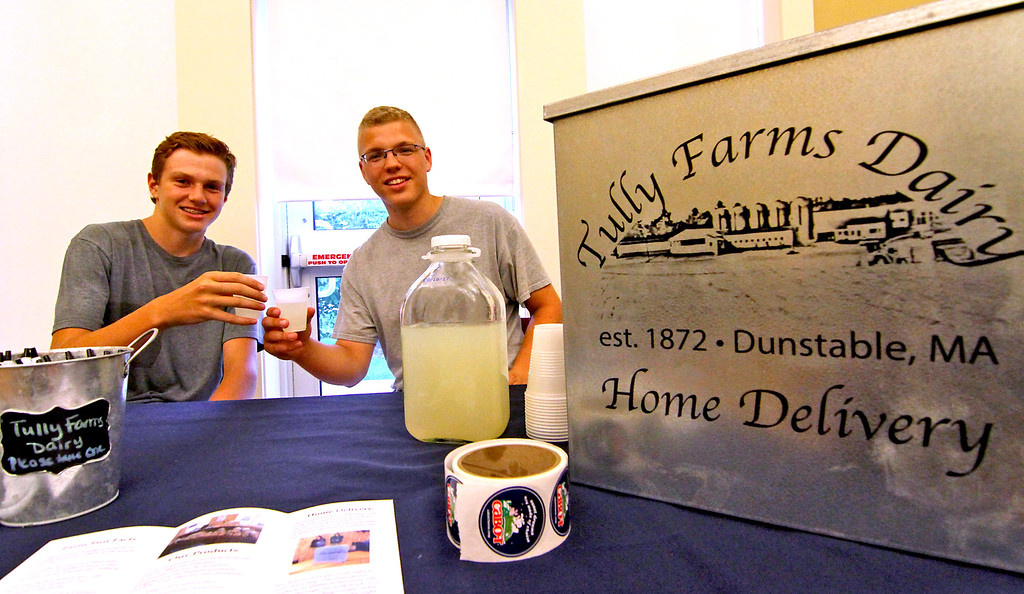 . Tristan Chase,15, and Steven Tully, 19, from Tully Farm in Dunstable, have a lemonadie toast at the National Night Out in Townsend. Nashoba Valley Voice Photo by David H. Brow