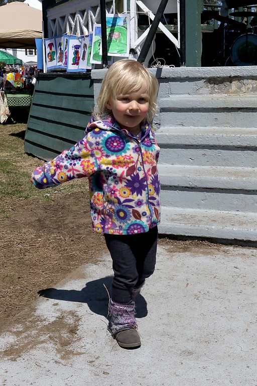 . Alice Branham, 2, dances to the music of Debbie and the Downers in front of the bandstand on the Townsend common Saturday during Townsend\'s Earth Day event. SENTINEL & ENTERPRISE/JOHN LOVE