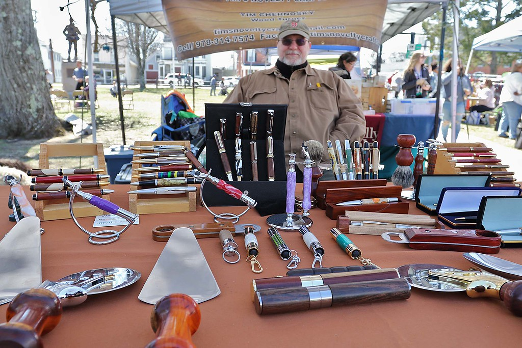 . Tim Chernosky from Townsend sits behind his wood and acrylic crafts he makes at his booth on the Townsend common Saturday during Townsend\'s Earth Day event. He calls his business Tim\'s Novelty Crafts. SENTINEL & ENTERPRISE/JOHN LOVE