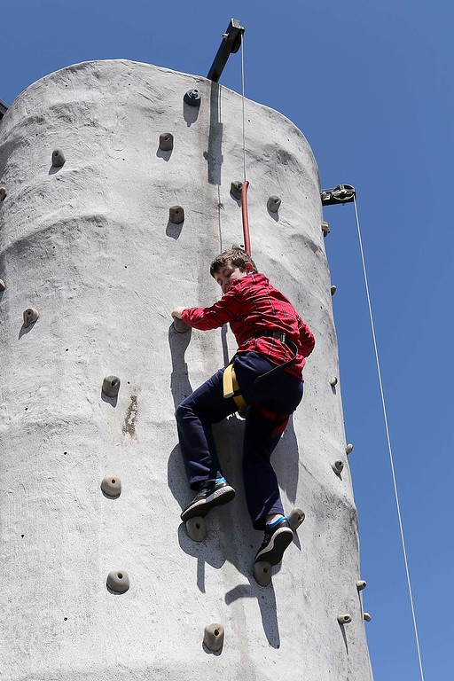 . Ryan Paterson, 10, from Nashua makes his way up the rockwall they had on the Townsend common Saturday during Townsend\'s Earth Day event. SENTINEL & ENTERPRISE/JOHN LOVE