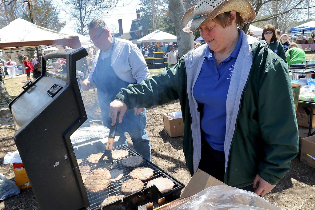 . Heide Messing a member of the Board of Directors for the 4H Camp Middlesex in Ashby does some of the cooking on the Townsend common Saturday during Townsend\'s Earth Day event. SENTINEL & ENTERPRISE/JOHN LOVE