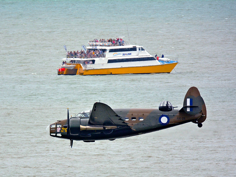 Australia's, and the world's, only airworthy Hudson files by the Magnetic Island Ferry.
